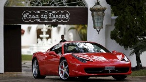 Police drive away a Ferrari from the home of Fernando Collor, a former president and sitting senator